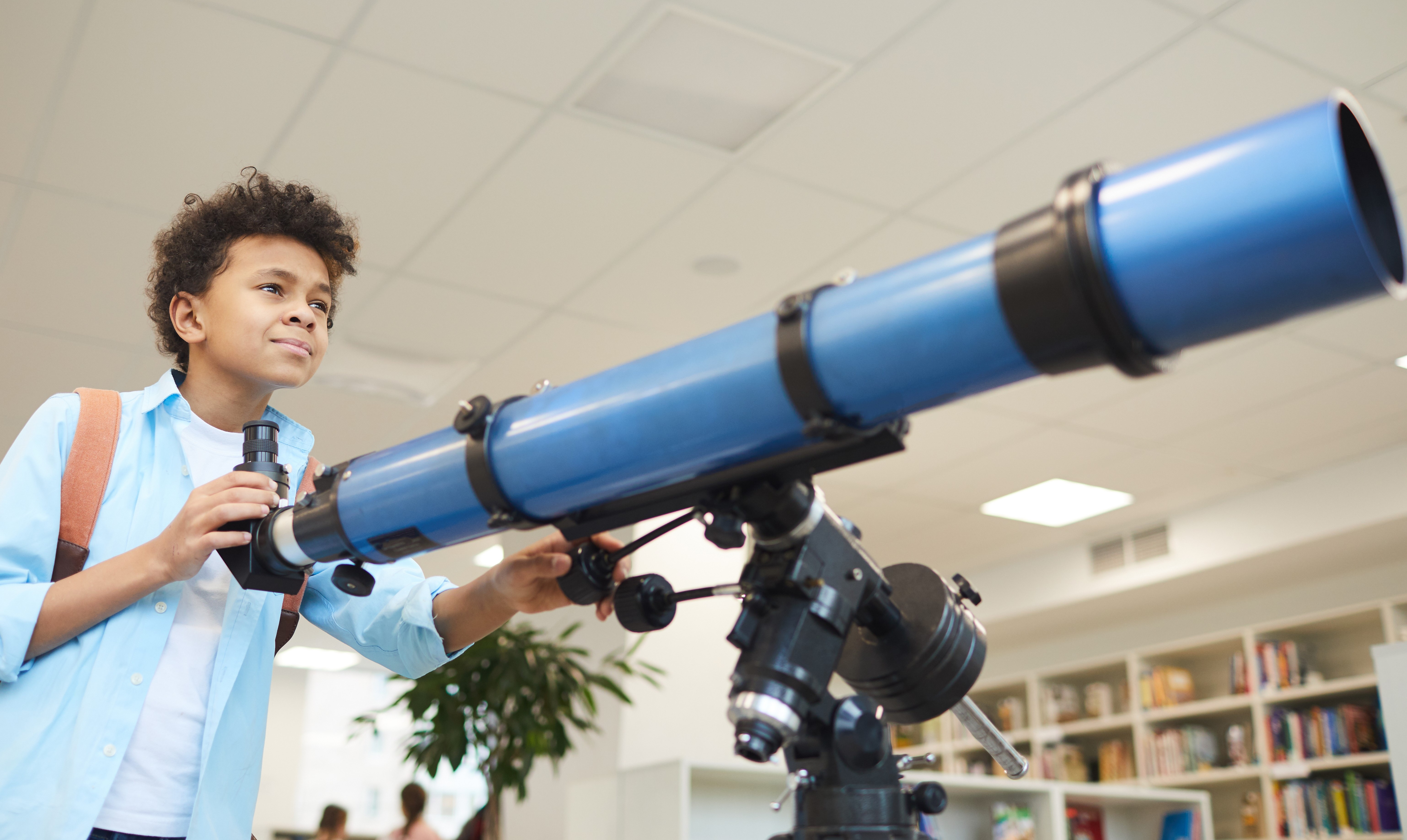 Kid with telescope